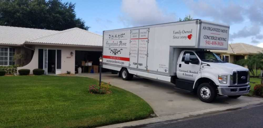 local moving truck parked in a residential driveway in Venice Florida